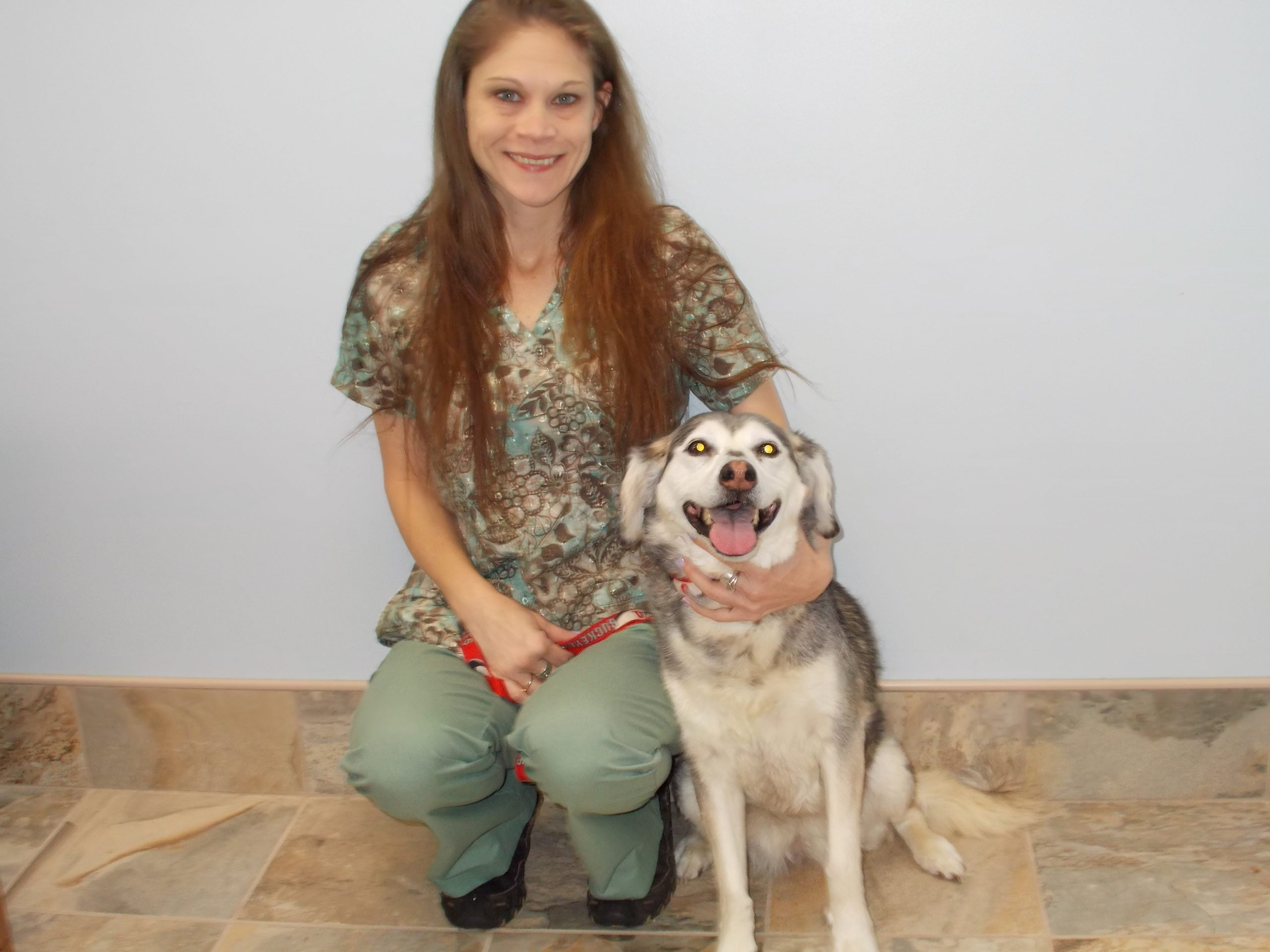 Team member Samantha with a happy dog